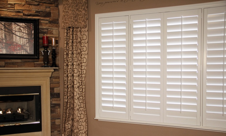 Austin Studio plantation shutters in family room.